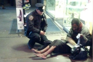 new-york-police-officer-homeless-man-boots-photo